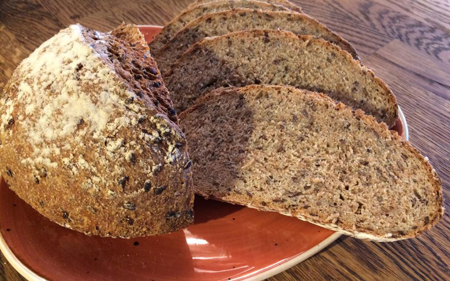 Freshly baked and sliced wholemeal sourdough bread