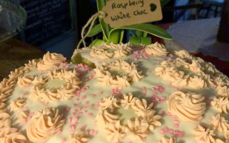 Beautiful Raspberry cake with fondant swirls