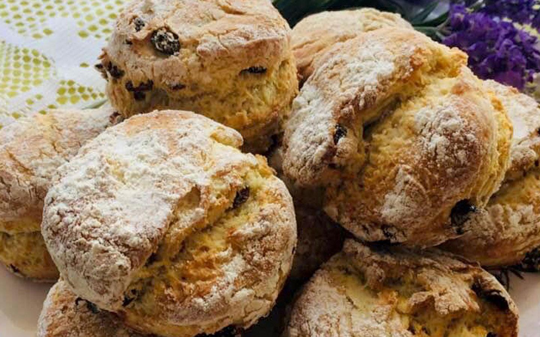 Flour coated freshly baked sourdogh fruit scones